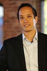 Photo of KPW Associate, Jonathan Wong in historic brick structure
